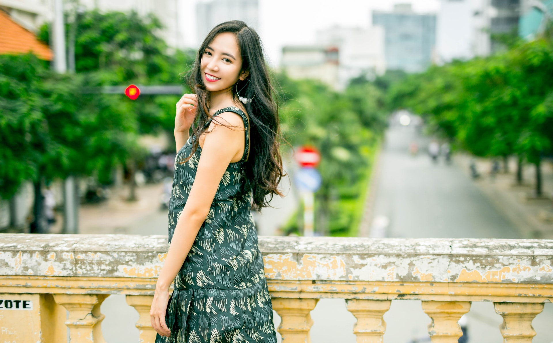 smiling asian girl in dress